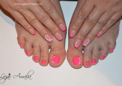 Pink nails on both hands and toes